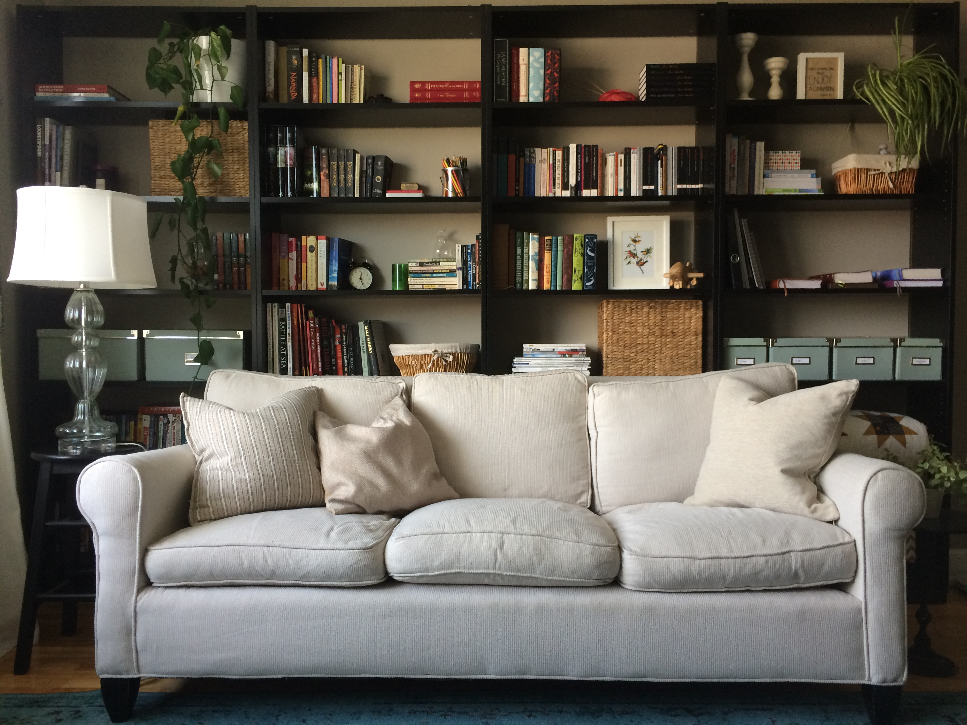 wall livingroom living couch dilemma lath plaster the ideas on and brick multiple painted of your twin hanging room wood shelf height big creative beds made hang storage behind funiture over with enchanting to contemporary design walls large pictures